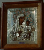 Иверская икона с серебряными рублями св. царя Николая